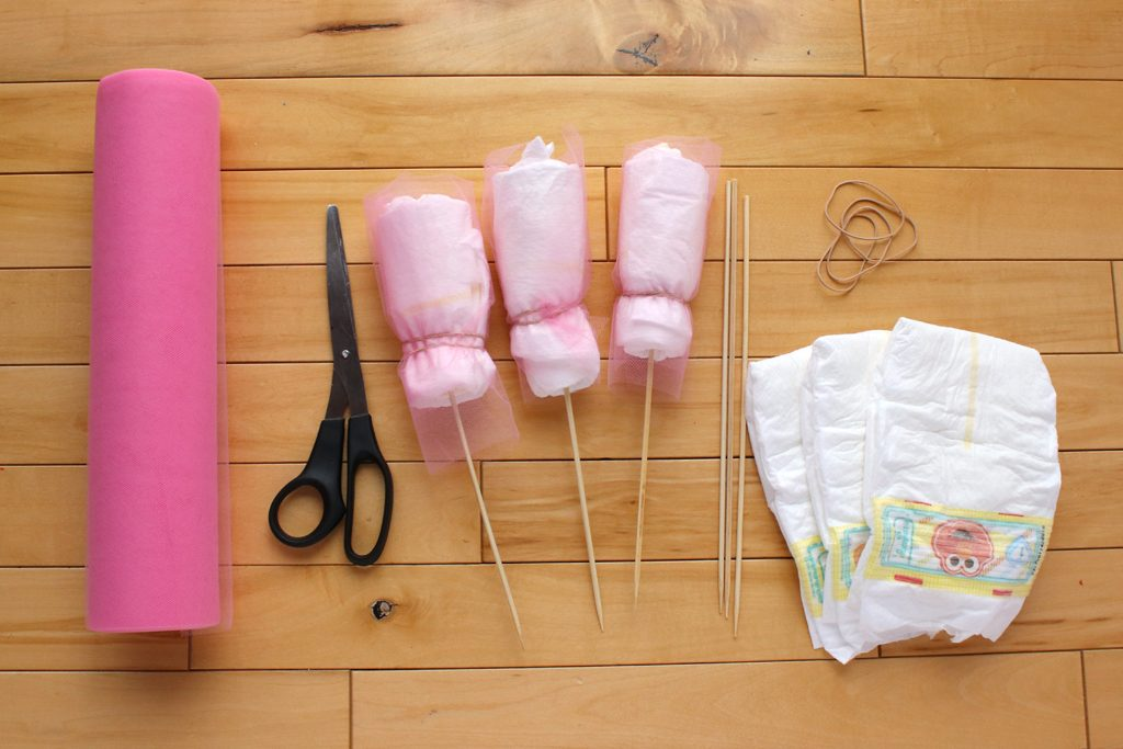Diy diaper bouquet baby shower gift party ideas for Pink diaper bouquet